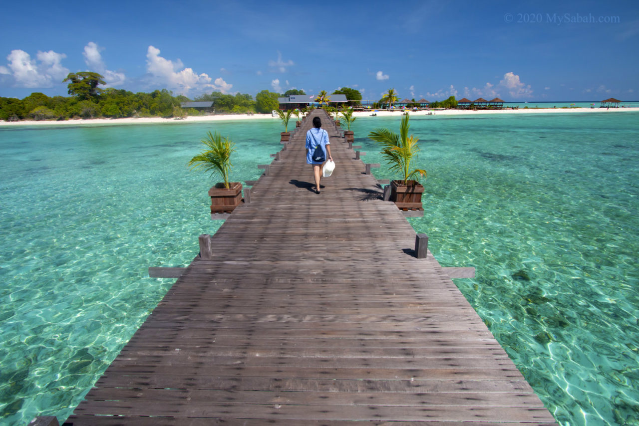 Walking on the boardwalk to Timba-Timba Island