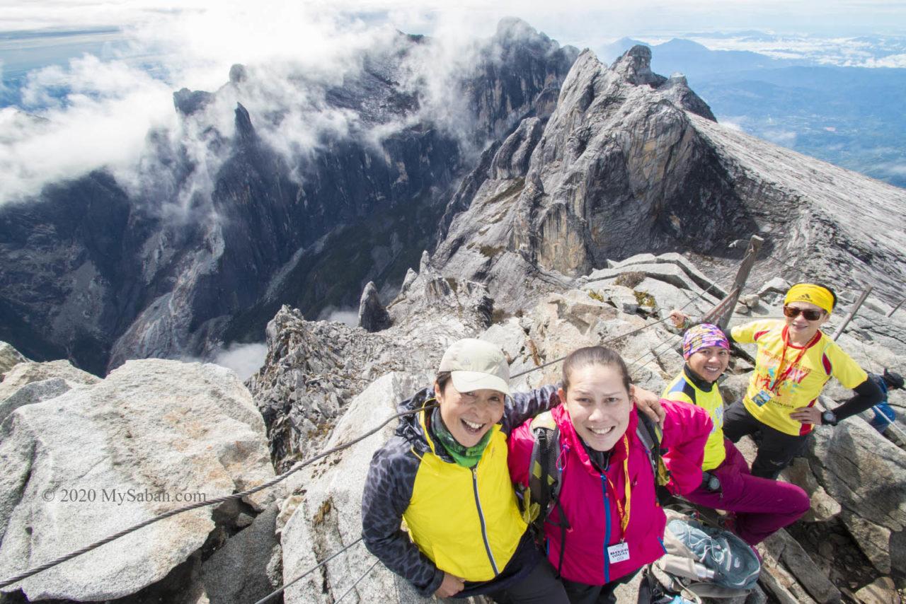 ladies on the summit of Mount Kinabalu